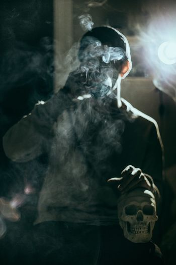 Close-up of man smoking