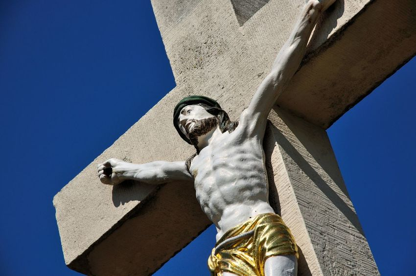 Close-up Diagonal Lines Gold Jesus Christ Light And Shadows No People Outdoors Religious Statues Sky