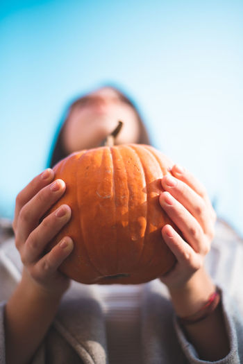 Autumn Mood Food And Drink Food Holding One Person Focus On Foreground Healthy Eating Human Hand Close-up Freshness Hand Wellbeing Day Real People Pumpkin Lifestyles Leisure Activity Child Human Body Part Front View Outdoors Jack O' Lantern