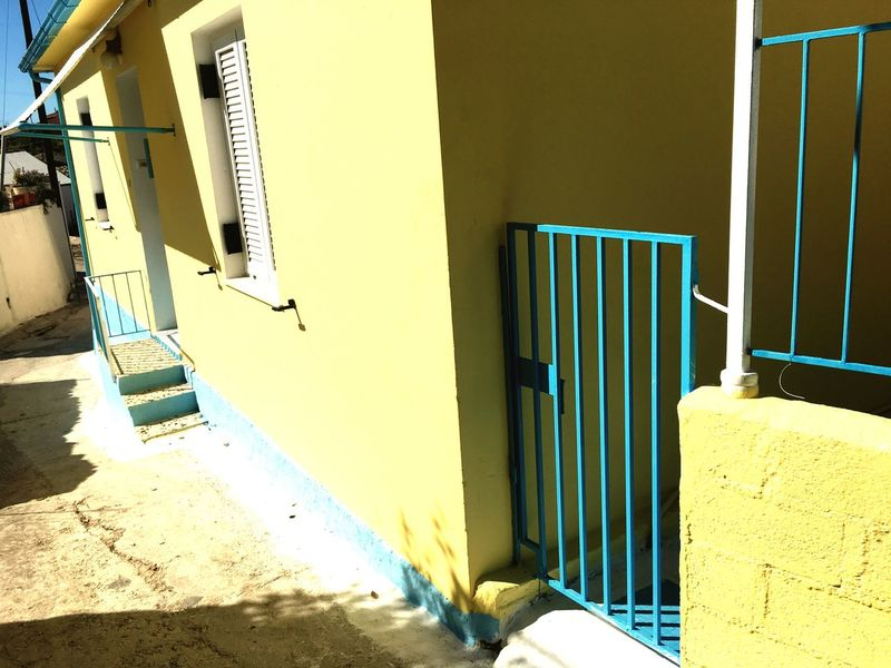 EyeEm Selects Architecture Built Structure Building Exterior No People Day Sunlight Outdoors Vacation Travel Destinations Holiday Kefalonia, Greece Ionian Islands Greek Islands Greece Yellow House  Blue Iron Fence
