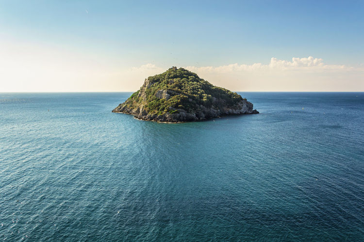 Scenic view of an island in a sunny day with beautiful blue sea