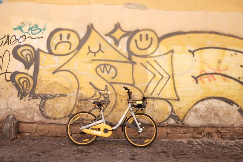 It was all yellow Colours Street Urban Lifestyles EyeEm Selects Wall - Building Feature Graffiti Bicycle Architecture Art And Craft Transportation Creativity Mode Of Transportation Built Structure Street Art Outdoors Mural Wall City
