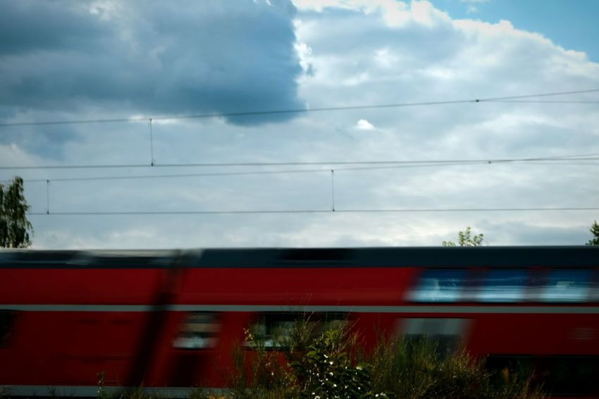Train - Vehicle Transportation Mode Of Transport Blurred Motion Rail Transportation Motion SpeedCloud - Sky Sky Land Vehicle No People Cable Day Outdoors Subway Train Tree Commuter Train Beauty In Nature Silhouette Photography Happiness Camera EyeEm Selects Public Transportation Passenger Train