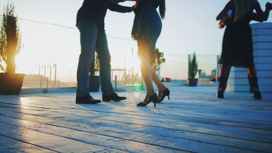 Real People Men Low Section Women Human Leg Leisure Activity Togetherness Lifestyles Well-dressed Day Friendship Outdoors Sky Adult People Adults Only Dancing Dance Latina Latin Dancers Terrace Adults Only Sunlight Bachata