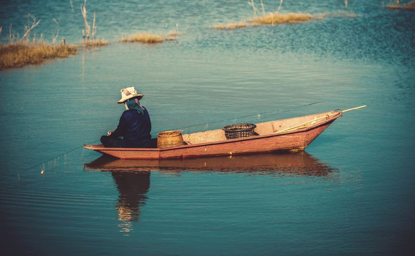 fisherman Fish Boat Water Nautical Vessel Transportation Waterfront One Person Mode Of Transportation Real People Lake Hat Fisherman Outdoors Reflection Men Nature