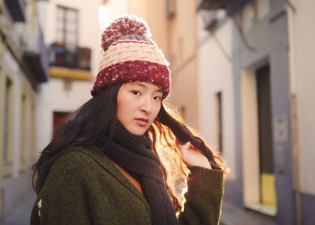 Girl in Seville Portrait Of A Woman Europe SPAIN Seville One Person Real People Architecture Built Structure Building Exterior Warm Clothing Leisure Activity Long Hair Focus On Foreground Looking At Camera Beautiful Woman Young Women Portrait Winter Outdoors Smiling Happiness
