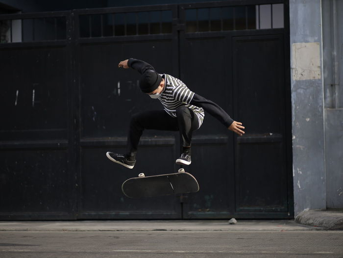 Full length of man jumping outdoors