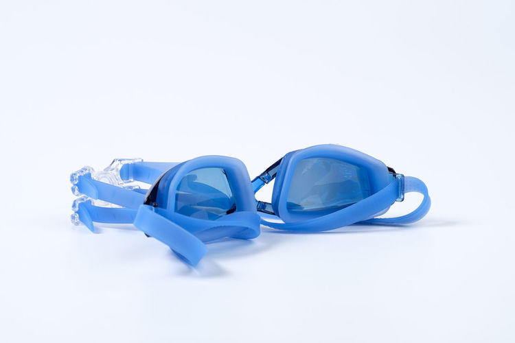 Blue Clean Equipment Glossy Goggle Goggles Rubber Swim Swimming Swimming Goggle White White Background Studio Shot Copy Space Indoors  Still Life No People Cut Out Close-up Two Objects White Color High Angle View Single Object Personal Accessory Group Of Objects Protection Security Table Design Plastic