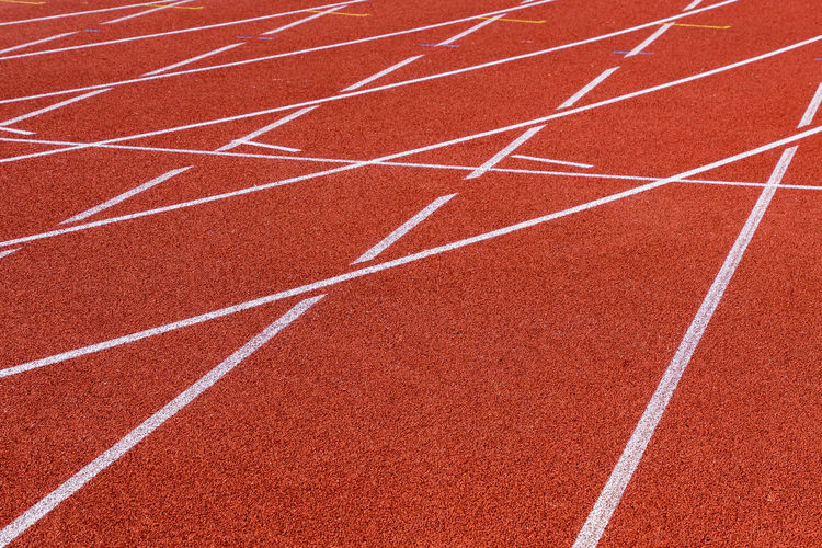 Lines Teamwork Team Sport Objectives Targets Running Orange Color Track And Field Running Track Sport Competition Red In A Row Curve No People Sports Track Sports Race Striped Outdoors Sports Venue Day Single Line Competitive Sport Stadium Exercising Dividing Line