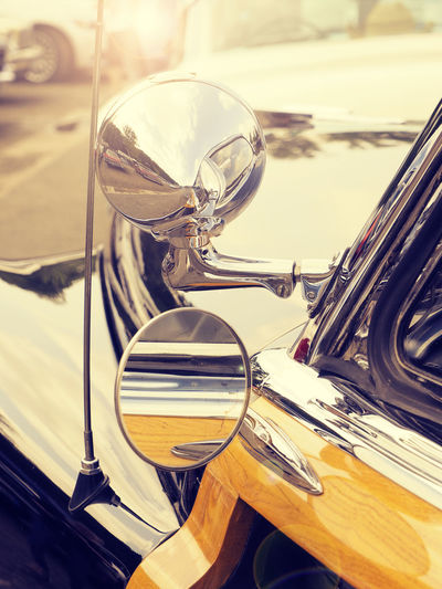 Detail of an old vintage car CarShow Meeting Mirror Rear View Show Sunlight Transportation Car Chrome Close-up Day Land Vehicle Lens Flares Mode Of Transport No People Nostalgic  Outdoors Reflection Reflections Stationary Summer Sunshine Transportation Vintage