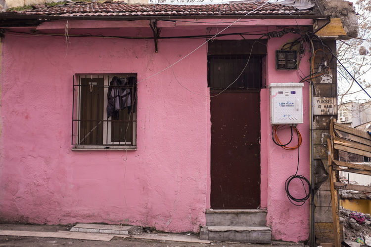 Very professional electrics. But why would you care, as long as your wall is pink?! Architecture Building Exterior Built Structure Cables Cords Day Door DoorsAndWindowsProject Doorsworldwide Electricity  Istanbul No People Outdoors Pink Pink Color Streetphotography Urban Urbanphotography