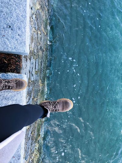 Low Section Water Human Leg Body Part Human Body Part One Person Day Nature Shoe Blue Real People Lifestyles High Angle View Close-up Unrecognizable Person Reflection Outdoors Sea