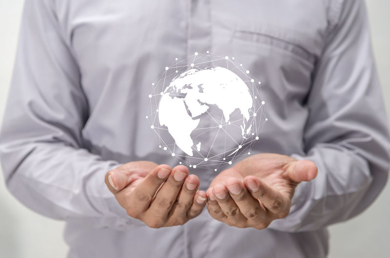 Save world save life Earth Go Green Save The World Save The Nature Connected Connection Environment Futuristic Holding Human Hand Men Midsection Network Networking One Person Planet Earth Save Save Life Save The Planet Saving Web World