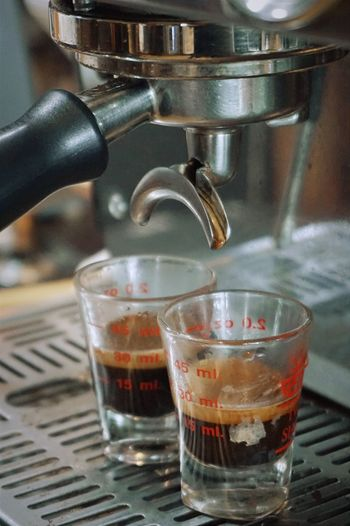 Close-up of coffee pouring in glass