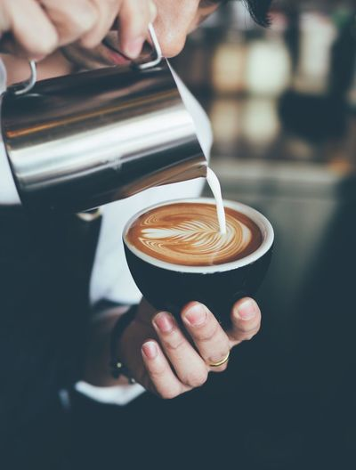 Coffee - Drink Coffee Cup Drink Cappuccino Food And Drink Refreshment Froth Art Latte Espresso Cafe Human Hand Frothy Drink Barista Making Pouring Holding Human Body Part Focus On Foreground Close-up Preparation