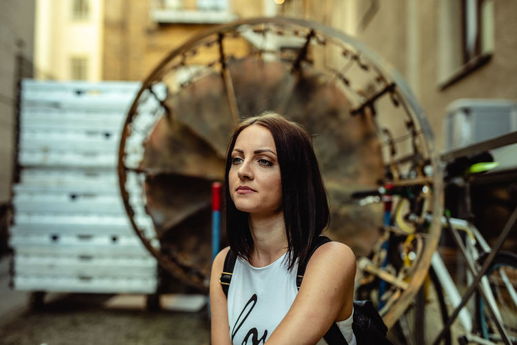 J Adult Beautiful Woman Beauty Clock Contemplation Focus On Foreground Front View Hairstyle Headshot Leisure Activity Lifestyles Looking Looking Away One Person Portrait Real People Sitting Wheel Women Young Adult Young Women