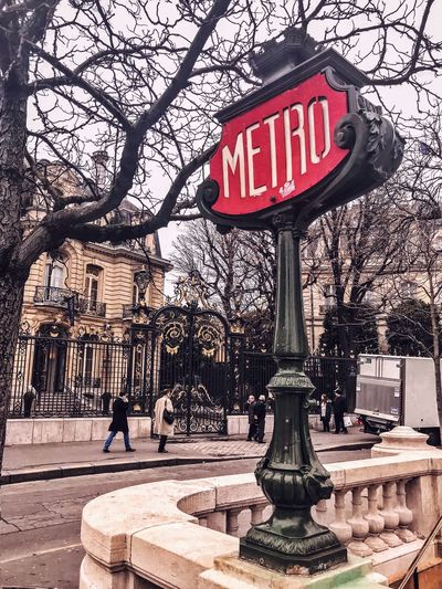 Metro Tree Bare Tree Outdoors Architecture Built Structure Street Light Day City Sky People Building Exterior Branch Red