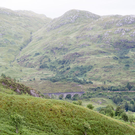Glenfinnan Viaduct - Featured in the Harry Potter Movies Harry Potter Scotland Day Glenfinnan Glenfinnan Viaduct Grass Hogwarts Express Mountain Nature No People Outdoors Railway Scenics Scottish Highlands Viaduct