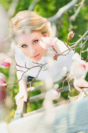 Enjoying a beautiful spring day! Plant Flower Flowering Plant One Person Young Adult Selective Focus Day Beauty In Nature Nature Portrait Lifestyles Growth Freshness Fragility Vulnerability  Young Women Adult Women Pink Color Beautiful Woman Outdoors Flower Head Magnolia Magnolia Flower