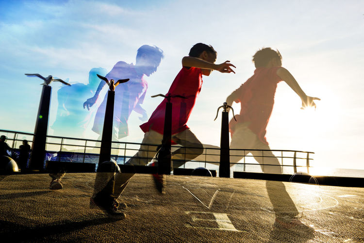 Action Shot  Adult Adventure Beautifully Organized Bonding Boy Running Boys Child Childhood Full Length Lifestyles Multiple Exposures Outdoors Real People Running Sequence Shot Silhouettes Son Sunlight Togetherness Embrace Urban Life Your Ticket To Europe