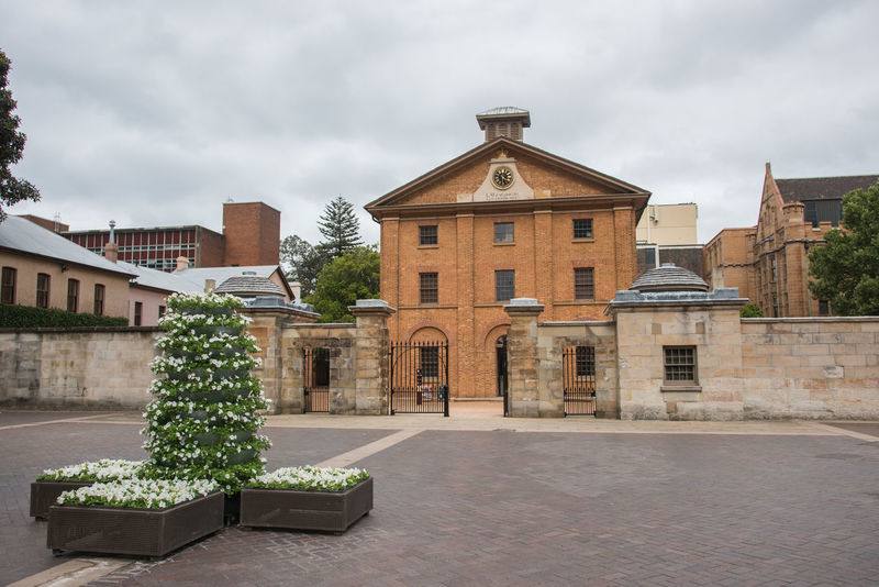 Sydney,NSW,Australia-November 19,2016: Hyde Parks Barracks Museum exterior with gateway in Sydney, Australia. Architecture Australia Boundary Entrance Gate Tourist Attraction  UNESCO World Heritage Site Wall World Heritage Barracks Brick Building Building Exterior Convict Heritage Building Historic Hyde Park Barracks Masonry Museum Old Buildings Overcast Queen's Square Site Sydney Tourism