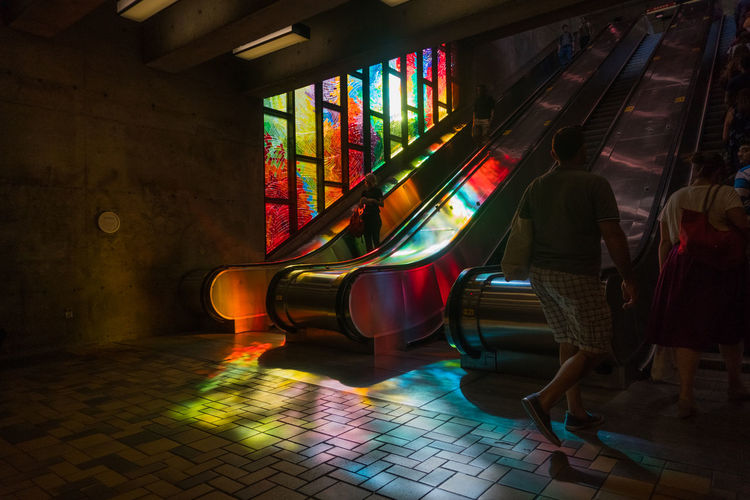 A photo I took in the Charlevoix metro station in Montreal Montréal Montreal, Canada Montrealcity Montrealphotography Montrealmetro Metro Color Colorlight Light Window Stainedglass Stainedglasswindows