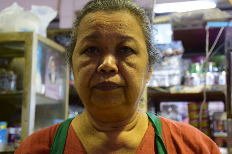 Portrait Of Senior Woman In Shop