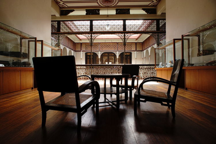 Empty chairs and table at blue mansion