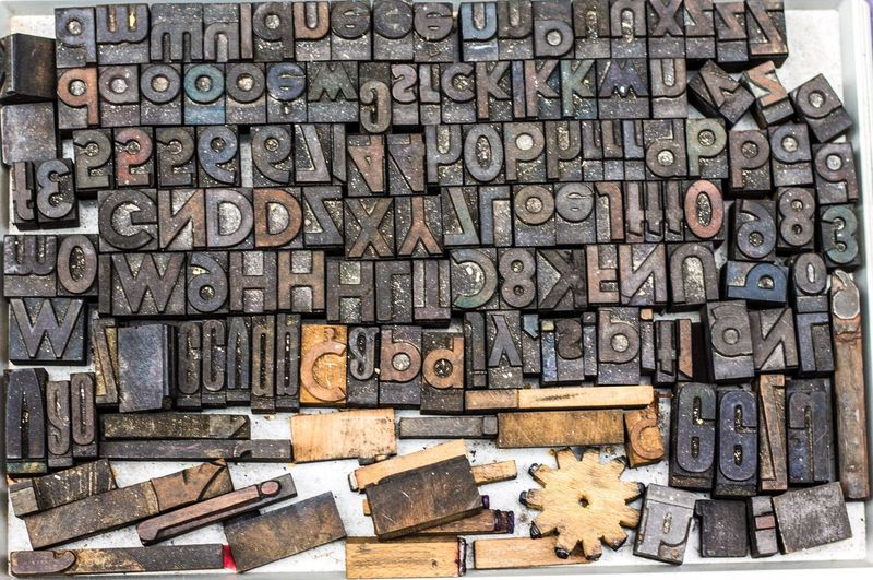 High angle view of wooden alphabets