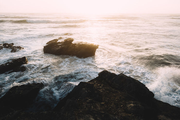 Travel View Beauty In Nature Breaking Coast Horizon Over Water Landscape Motion No People Power In Nature Rock Rocky Coastline Scenics - Nature Sea Sunset Travel Destinations Water Wave