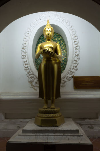 Art And Craft Day Gold Colored Human Representation Indoors  Male Likeness No People Religion Sculpture Spirituality Statue Thailand Nakhon Pathom Gold Yellow Buddha Real People Buddha Status Standing Old Buddha Outdoors Site Down Buddha Large Group Of People Buddha Standing Old Buddha Statue Travel