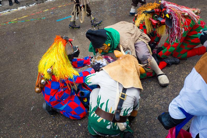 People in fancy dress costumes on street
