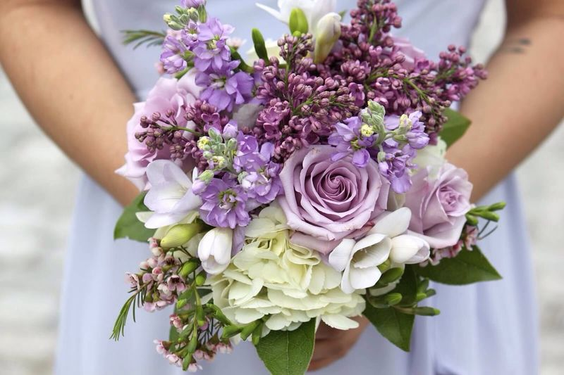 Close-up of woman holding bouquet