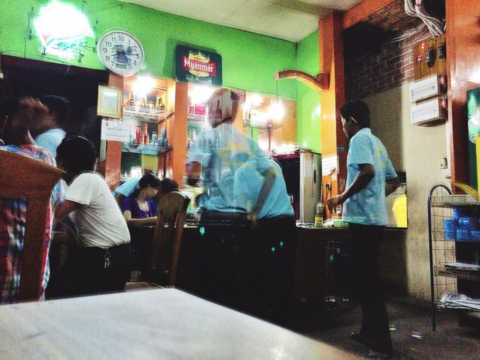 Waiters gather at the cashier desk at a busy local beer garden and restaurant with their orders Traveling Streetphotography Mm2015