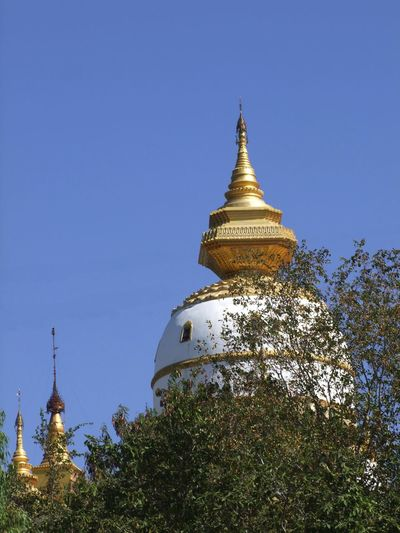 Stupas at Bodi Tataung Giant Buddhas Blue Sky Bodi Tataung Giant Buddhas Buddhism Buddhist Architecture Buddhist Culture Buddhist Stupas Famous Place Monywa Myanmar No People Outdoor Photography Place Of Pilgrimage Place Of Prayer Place Of Worship Religion Travel Destination Tree Unusual Shape.