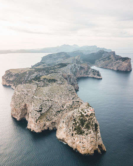 Calm morning in Mallorca Water Sea Beauty In Nature Scenics - Nature Tranquil Scene Rock Rock - Object Tranquility High Angle View Nature No People Rock Formation Cloud - Sky Day Idyllic Land Outdoors Coastline Coast Lighthouse Sunrise Rock Formation
