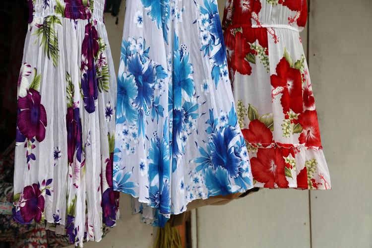 Dresses hanging at market stall