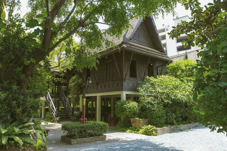 Thai house House Formal Garden Built Structure Traditional Clothing Wooden House Outside Building Architectural Column Architecture