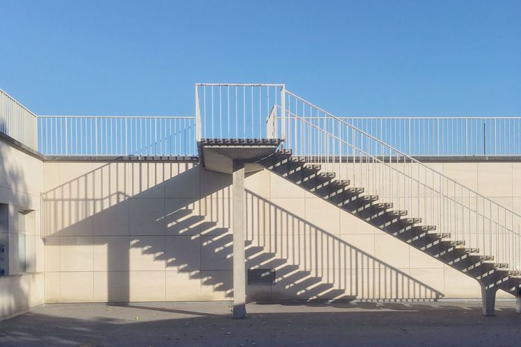 Staircase against clear blue sky