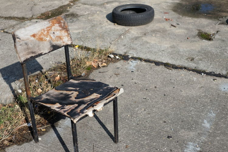High Angle View Of Burnt Chair