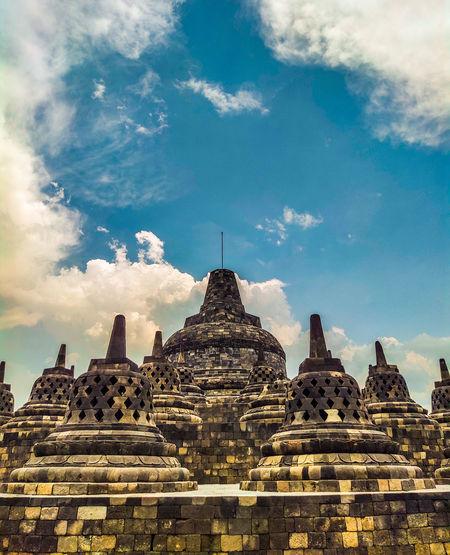Panoramic view of temple building against sky at borobudur, magelang, yogyakarta, indonesia