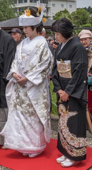 Japanese bride in traditional wedding attire during the annual Suigo Itako Iris Flower Festival. Attire Bride Ceremony Costume Culture Custom Dress Festival Girl Itako Japan Japanese  Joyous Marriage  Occasion Solemn Tourism Tourist Attraction  Wedding White Woman