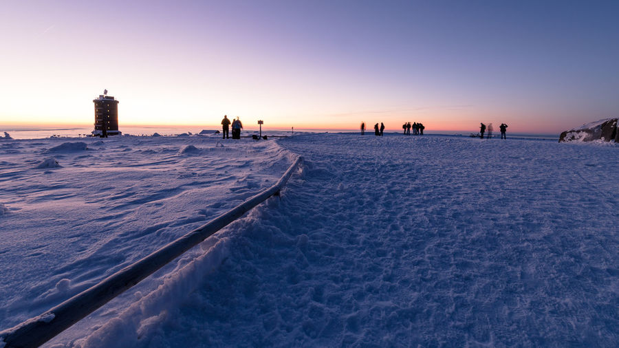 Sky Sunset Nature Scenics - Nature Beauty In Nature Land Snow Built Structure Architecture Clear Sky Winter Water Tranquility Incidental People Tranquil Scene Cold Temperature Building Exterior Non-urban Scene Horizon Outdoors Brocken Harz Harzmountains Winter Sunrise