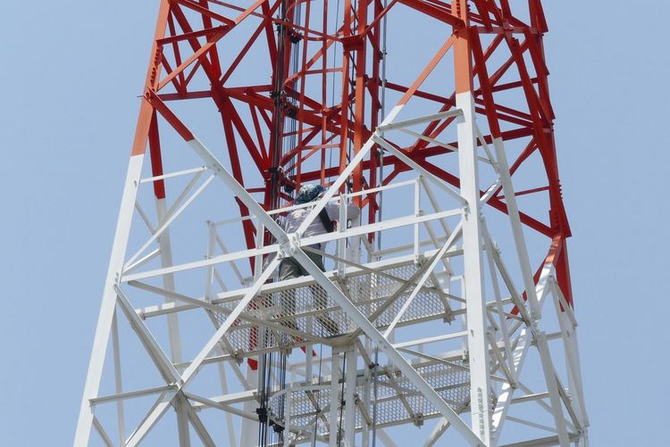 A Man Working on Antenna Transmission Tower Antenna Thai Working Hard Background Close-up Job Low Angle View Outdoors Sky Transmission Tower