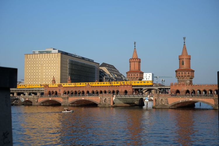 Train On Oberbaumbruecke Over Spree River Against Clear Sky