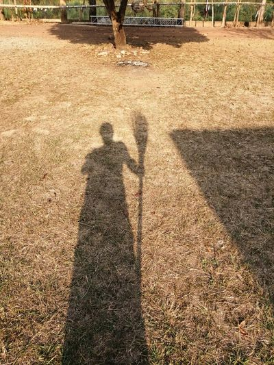 Low Section Men Togetherness Beach Shadow Sand Sunlight High Angle View Focus On Shadow Human Leg