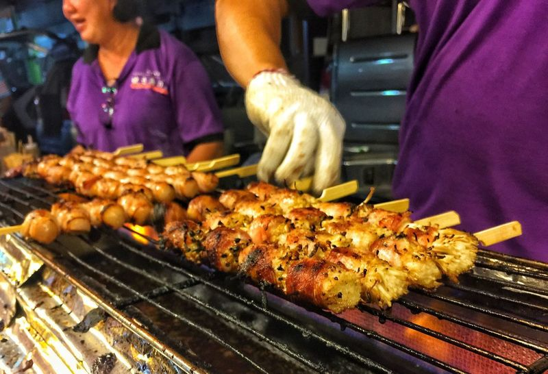 Yakitori foodtrip foodhunting Street Food Worldwide Business Stories Foodtrip Foodhunting Patient Glove Charcoal Fire Bacons Grilled Barbecue Barbecue Grill Food Preparation  EyeEmNewHere Meat Heat - Temperature Kebab Outdoors Real People Close-up