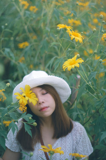Beautiful woman with yellow flower