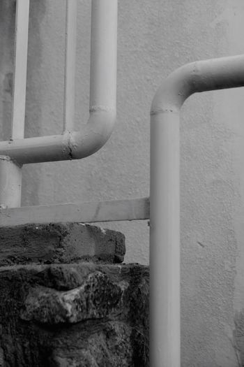 Street Pipe - Tube Built Structure Wall - Building Feature Architecture Building Exterior Day No People Pipe Wall Outdoors Metal Close-up Textured  Concrete