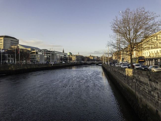 Liffey Dublin Architecture Bare Tree Building Exterior Built Structure Canal City Clear Sky Day Liffey Nature No People Outdoors Sky Transportation Tree Water Waterfront